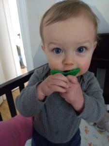 baby with berry buddy teether